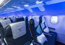Салон эконом-класса a Airbus A320neo Air Astana
