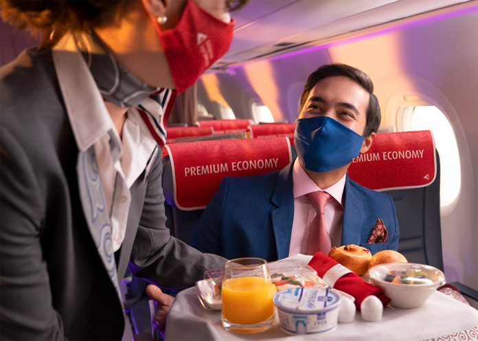 Пассажир в премиум-эконом-классе на борту Air Astana